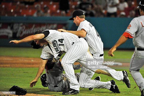 Gaby Sanchez of the Florida Marlins clotheslines Nyjer Morgan of the Washington Nationals after Morgan charged the mound at pitcher Chris Volstad of...