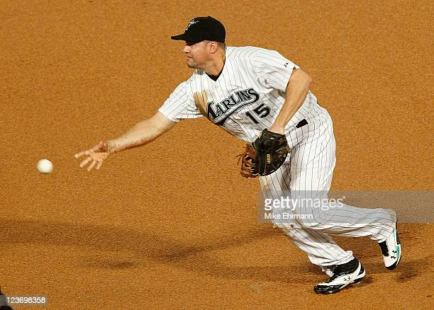 Gaby Sanchez of the Florida Marlins tosses the ball to first during a game against the Philadelphia Phillies at Sun Life Stadium on September 3 2011...