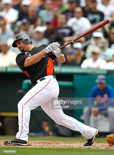 Gaby Sanchez of the Miami Marlins bats during a game against the New York Mets at Roger Dean Stadium on March 7 2012 in Jupiter Florida
