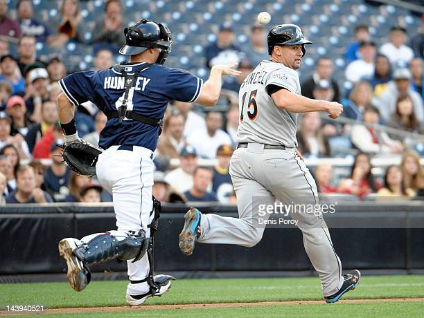 Gaby Sanchez of the Miami Marlins gets caught in a run down Nick Hundley of the San Diego Padres during the fifth inning of a baseball game at Petco...