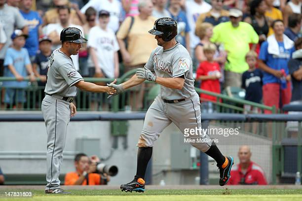 Gaby Sanchez of the Miami Marlins runs the bases after hitting a solo home run off of Brewers closer John Axford in the top of the 9th inning tying...