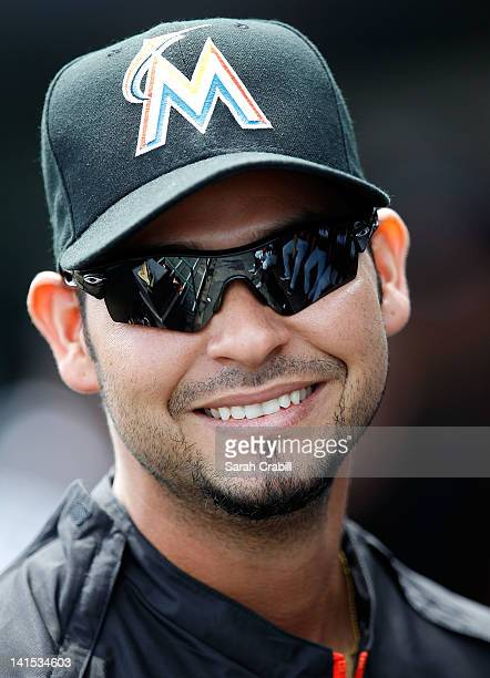 Gaby Sanchez of the Miami Marlins smiles before a game against the St Louis Cardinals at Roger Dean Stadium on March 18 2012 in Jupiter Florida