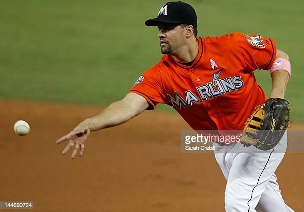 Gaby Sanchez of the Miami Marlins tosses the ball for an out at first during a game against the New York Mets at Marlins Park on May 13 2012 in Miami...