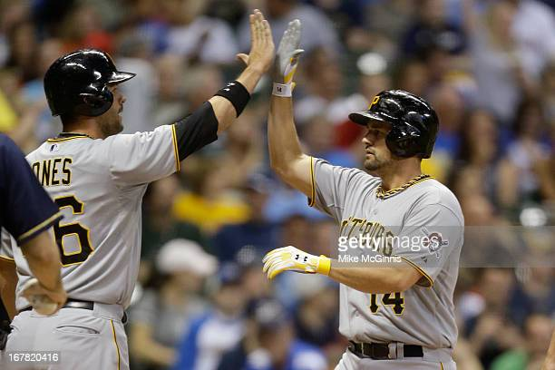 Gaby Sanchez of the Pittsburgh Pirates celebrates at home plate after hitting a tworun homer scoring Garrett Jones in the top of the third inning...