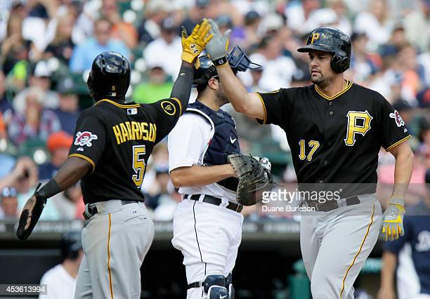 Gaby Sanchez of the Pittsburgh Pirates receives a highfive from Josh Harrison of the Pittsburgh Pirates after hitting a pinchhitter home run against...