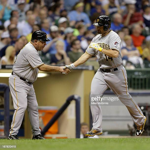 Gaby Sanchez of the Pittsburgh Pirates runs the bases after hitting a tworun homer scoring Garrett Jones in the top of the third inning against the...