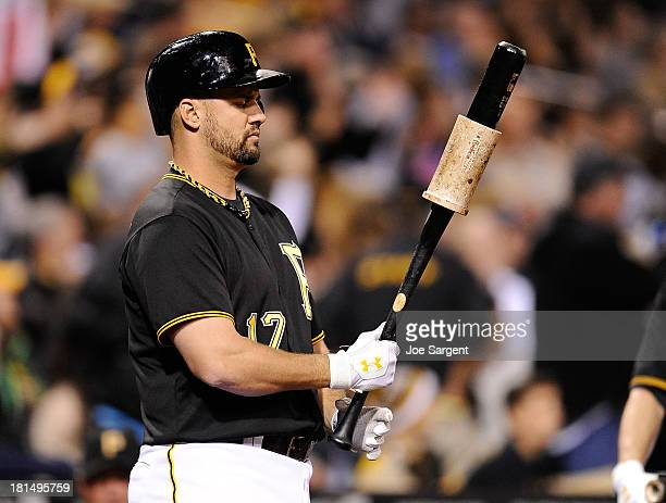Gaby Sanchez of the Pittsburgh Pirates waits in the on deck circle during the game against the Chicago Cubs on September 14 2013 at PNC Park in...