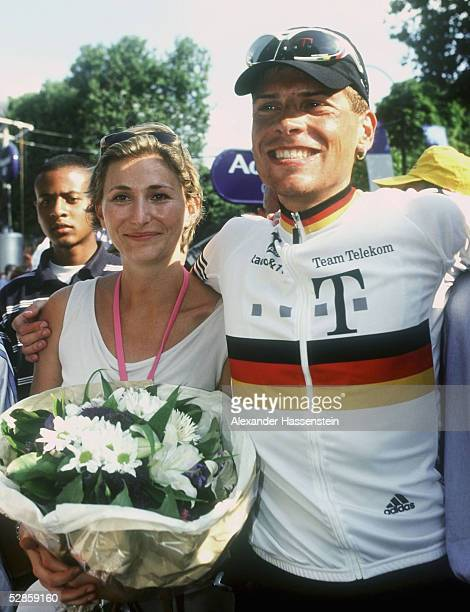 Gaby Weiss girlfriend of leader of the Deutsche Telekom team German Jan Ullrich stands with Jan Ullrich at the beginning of the last stage of the...