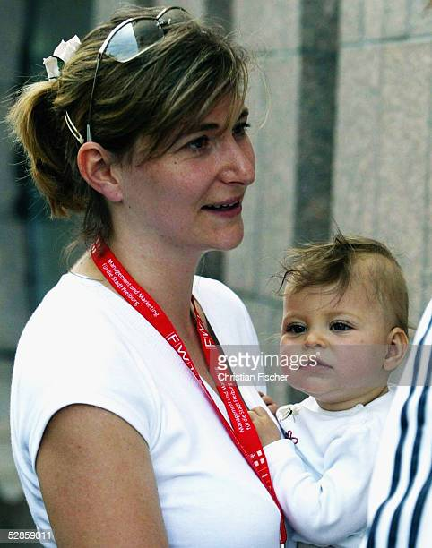 Gaby Weiss the girlfriend of German cyclist Jan Ullrich holds their daughter Sarah Marie as she attends the German Road Championship 2004 on June 27...