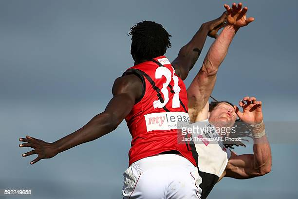 Gach Nyuon of Essendon and Matthew Eagles of North Ballarat compete for the ball during the round 20 VFL match between North Ballarat and Essendon at...