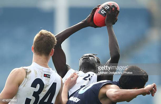 Gach Nyuon of Vic Country marks the ball during the U18 Championship match between Vic Metro and Vic Country at Simonds Stadium on May 24 2015 in...