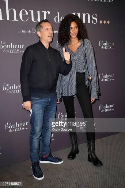 "Gad Elmaleh and Cindy Bruna attend the ""Le Bonheur Des Uns"" Premiere at Pathe Opera on September 08, 2020 in Paris, France."