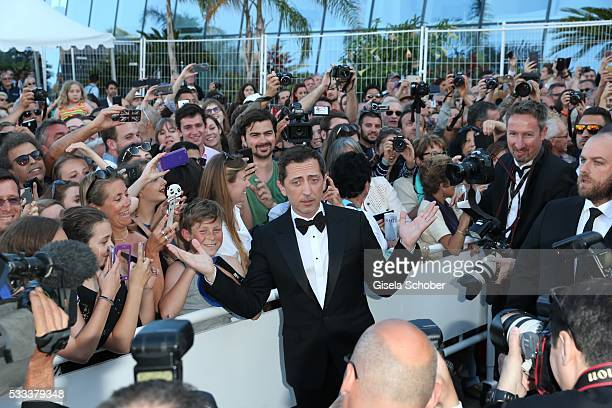 """Gad Elmaleh and Fans attend the """"Elle"""" Premiere during the 69th annual Cannes Film Festival at the Palais des Festivals on May 21, 2016 in Cannes,..."""