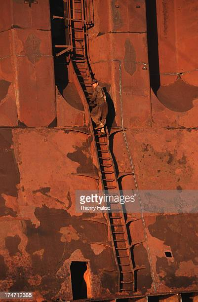 Gadani ships demolition yard A worker is climbing the ladder of a cargo ship being dismantled This was the final destination for the Canberra a...