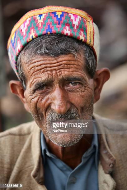 Gaddi man wearing a traditional cap in the Mandher Village, Himachal Pradesh, India.