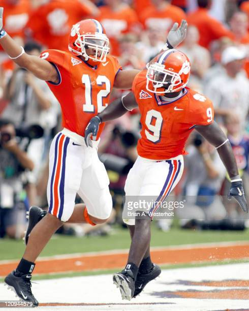 CJ Gaddis celebrates with Justin Miller after Miller returned a punt 69yards for a touchdown at the end of the first quarter of Clemson's 3730 2OT...