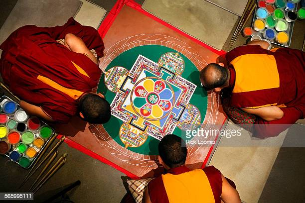 Gaden Jangtse Monks work into a third day creating a sand mandala at the Pacific Asian Museum in Pasadena on Friday morning The creation with be...