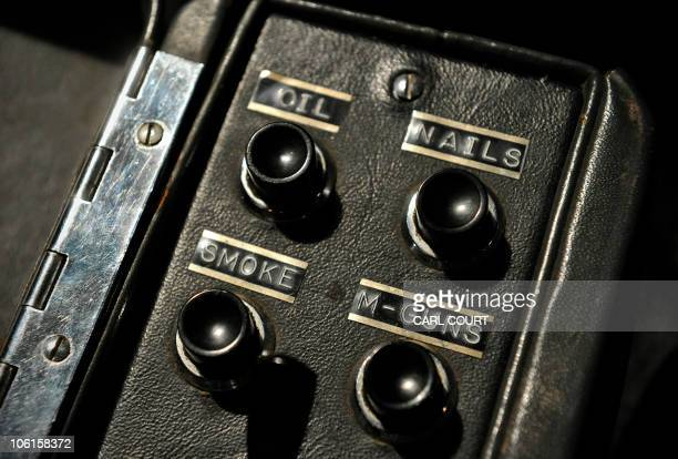 Gadget switches are pictured inside a 1964 Aston Martin DB5 vehicle used by British actor Sean Connery when he played fictional spy charachter James...