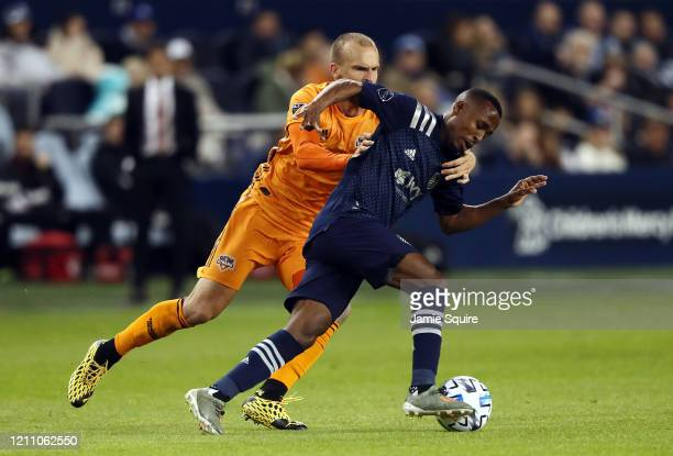 Gadi Kinda of Sporting Kansas City controls the ball as Aljaz Struna of Houston Dynamo chases during the game at Children's Mercy Park on March 07...