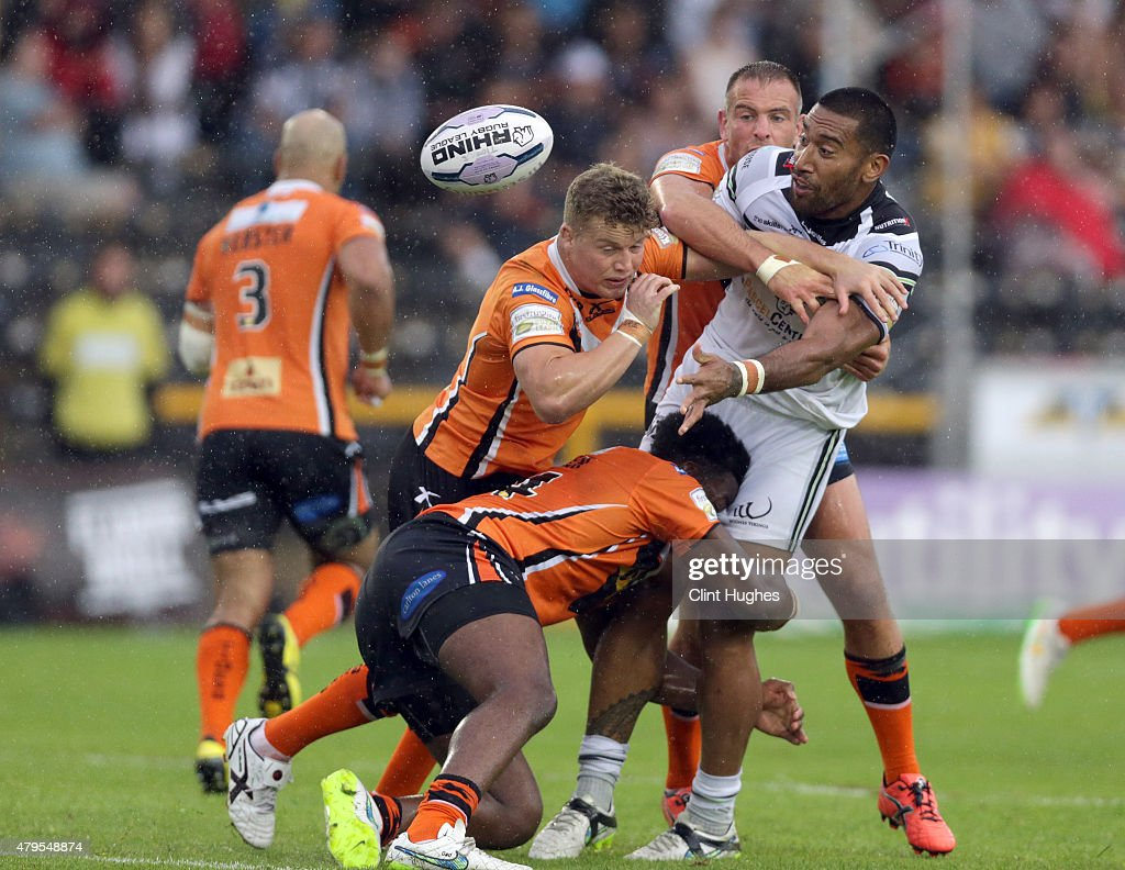 Gadwin Springer (Bottom left) of Castleford Tigers tackles Manase Manuokafoa (R) of Widnes Vikings during the First Utility Super League match between Castleford Tigers and Widnes Vikings at The Jungle on July 5, 2015 in Castleford, England.