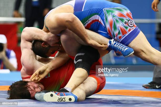 Gadzihiyev Nurmagomed of Azerbaijan and Mohammadi Amir of Iran compete in the Men's Freestyle Wrestling 97kg Gold Medal during day eight of Baku 2017...