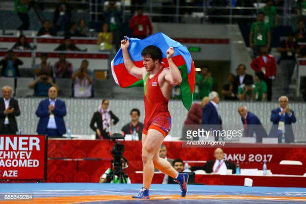 Gadzihiyev Nurmagomed of Azerbaijan celebrates his victory against Mohammadi Amir of Iran in the Mens Freestyle Wrestling 97kg Gold Medal during day...
