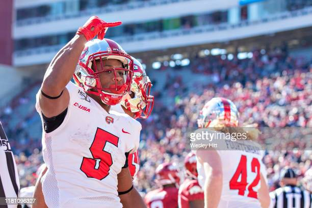 Gaej Walker of the Western Kentucky Hilltoppers celebrates after running in for a touchdown during the first half of a game against the Arkansas...