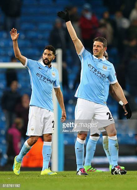 Gael Clichy and Martin Demichelis of Manchester City salute the crowd as they reach the quarter finals after the UEFA Champions League round of 16...