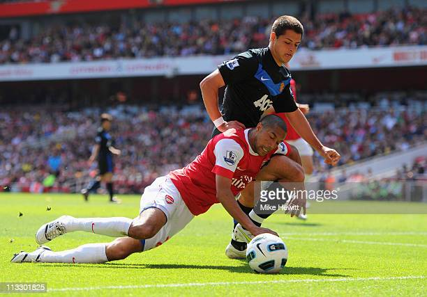 Gael Clichy of Arsenal battlea with Javier Hernandez of Manchester United during the Barclays Premier League match between Arsenal and Manchester...