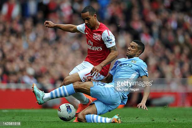 Gael Clichy of Man City tackles Theo Walcott of Arsenal during the Barclays Premier League match between Arsenal and Manchester City at Emirates...