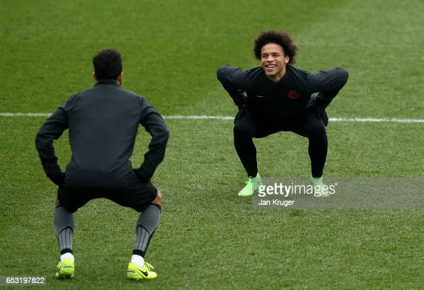 Gael Clichy of Manchester City and Leroy Sane of Manchester City share a smile during Manchester City training session prior to the UEFA Champions...