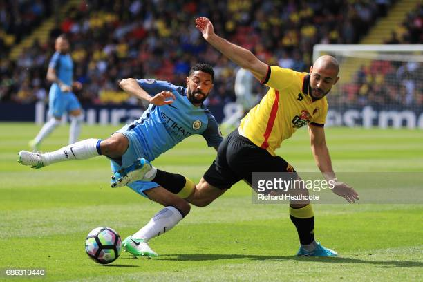 Gael Clichy of Manchester City and Nordin Amrabat of Watford battle for possession during the Premier League match between Watford and Manchester...