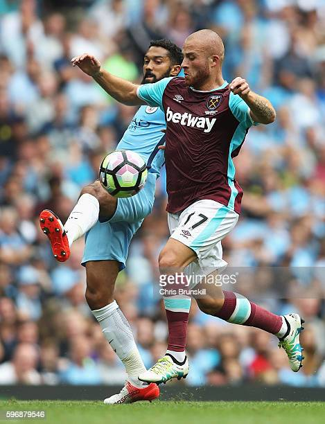 Gael Clichy of Manchester City challenges Gokhan Tore of West Ham United during the Premier League match between Manchester City and West Ham United...
