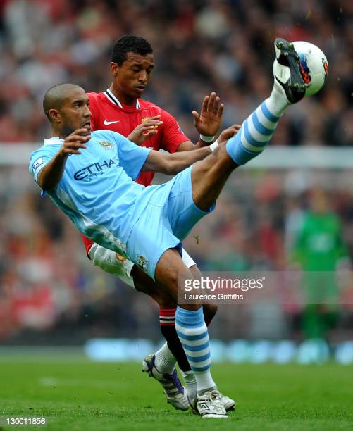 Gael Clichy of Manchester City competes with Nani of Manchester United during the Barclays Premier League match between Manchester United and...