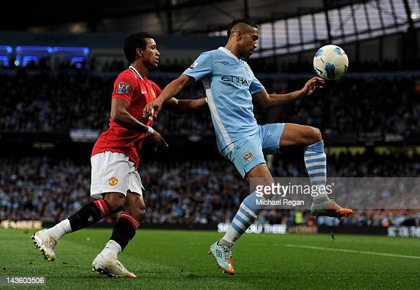 Gael Clichy of Manchester City competes with Nani of Manchester United during the Barclays Premier League match between Manchester City and...