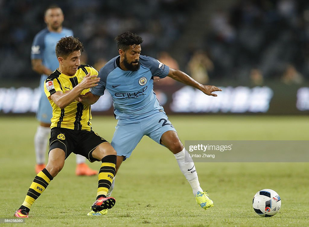 Gael Clichy (R) of Manchester City contests the ball against Emre Mor of Borussia Dortmund during the 2016 International Champions Cup match between Manchester City and Borussia Dortmund at Shenzhen Universiade Stadium on July 28, 2016 in Shenzhen, China.