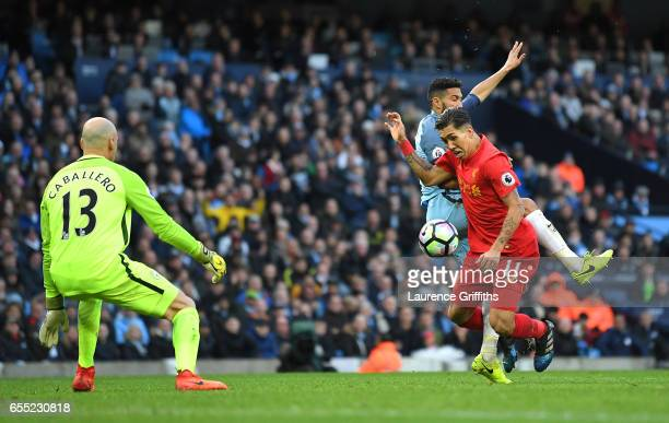 Gael Clichy of Manchester City fouls Roberto Firmino of Liverpool inside the box and a penalty is awarded to Liverpool during the Premier League...