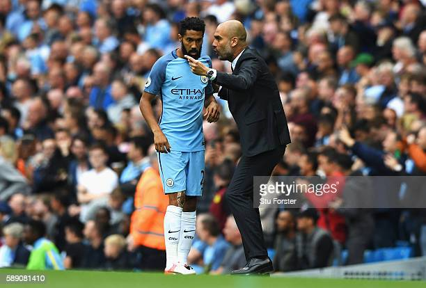 Gael Clichy of Manchester City gets instructins from Josep Guardiola Manager of Manchester City during the Premier League match between Manchester...