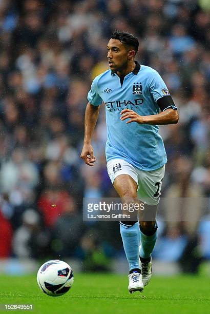 Gael Clichy of Manchester City in action during the Barclays Premier League match between Manchester City and Arsenal at Etihad Stadium on September...