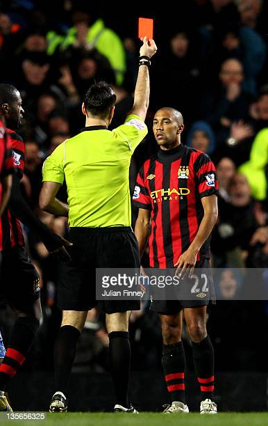 Gael Clichy of Manchester City is shown the red card by Referee Mark Clattenburg during the Barclays Premier League match between Chelsea and...