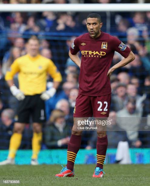 Gael Clichy of Manchester City looks dejected following Everton's second goal during the Barclays Premier League match between Everton and Manchester...
