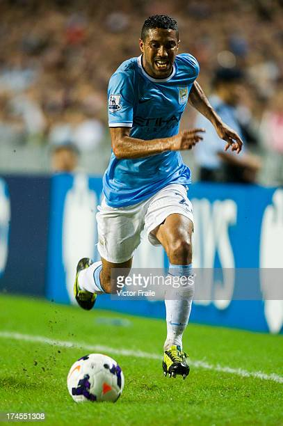 Gael Clichy of Manchester City runs with the ball during the Barclays Asia Trophy Final match between Manchester City and Sunderland at Hong Kong...