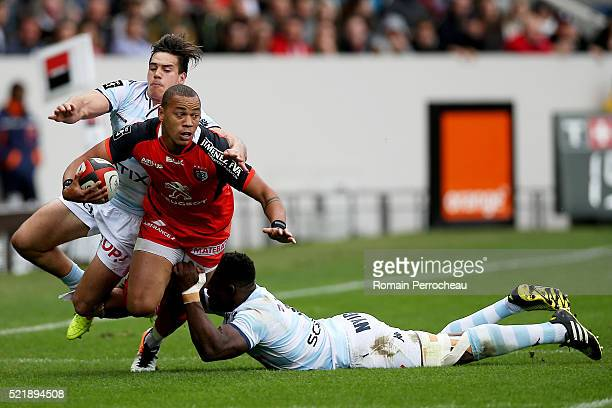Gael Fickou for Toulouse is tackled by Yannick Nyanga and Sean Robinson for Racing 92 during the French Top 14 rugby union match between Toulouse v...