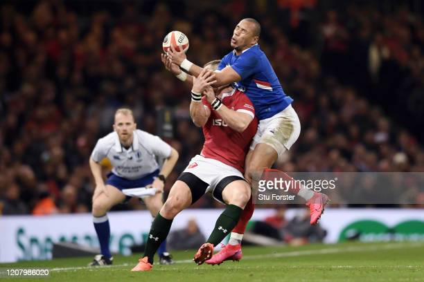Gael Fickou of France and George North of Wales collide in the air causing George North to go off for a HIA during the 2020 Guinness Six Nations...