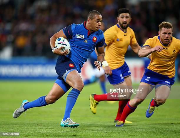 Gael Fickou of France breaks to score his teams fifth try during the 2015 Rugby World Cup Pool D match between France and Romania at the Olympic...