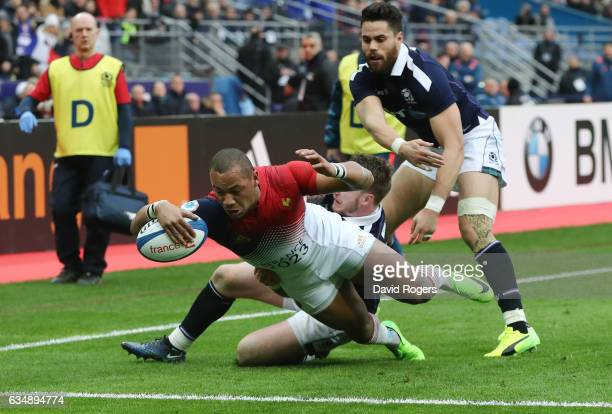 Gael Fickou of France dives over to score his team's opening try during the RBS Six Nations match between France and Scotland at Stade de France on...