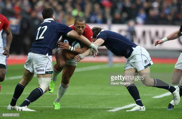 Gael Fickou of France is tackled by Alex Dunbar and Hamish Watson during the RBS Six Nations match between France and Scotland at Stade de France on...
