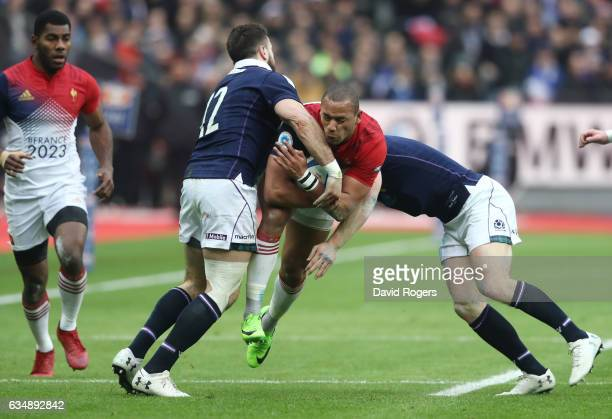 Gael Fickou of France is tackled by Alex Dunbar and Stuart Hogg of Scotland during the RBS Six Nations match between France and Scotland at Stade de...