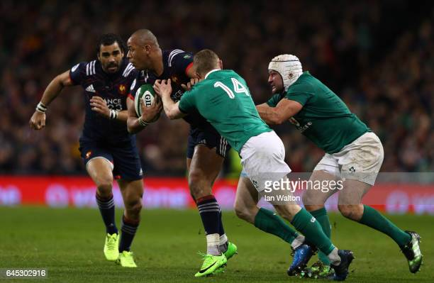 Gael Fickou of France is tackled by Keith Earls and Rory Best of Ireland during the RBS Six Nations match between Ireland and France at the Aviva...