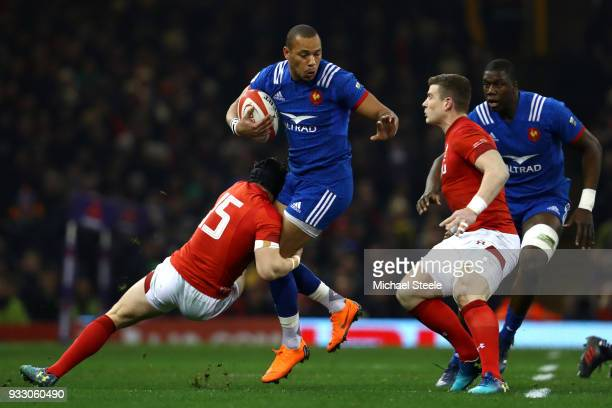 Gael Fickou of France is tackled by Leigh Halfpenny of Wales during the NatWest Six Nations match between Wales and France at Principality Stadium on...